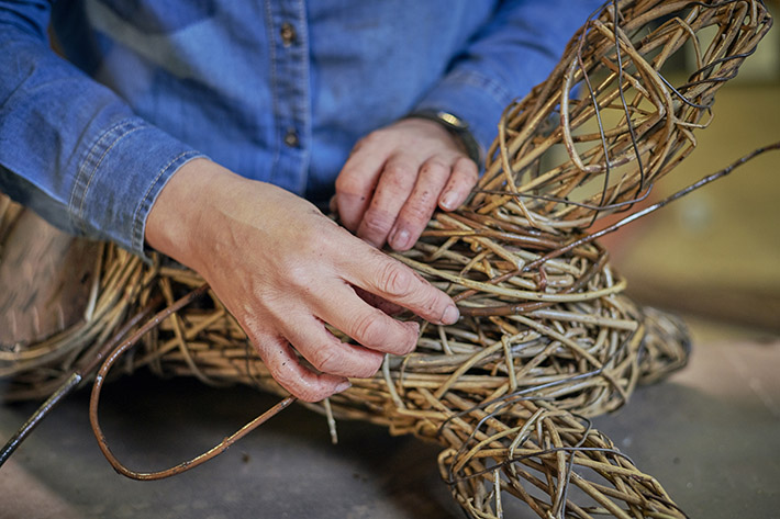 Working with willow in her studio © VisitBritain/Sam Barker