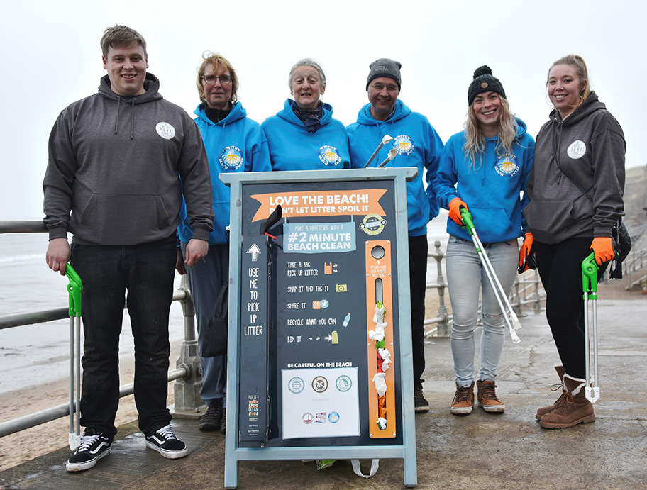 Beech Sweep volunteers by 2 minute beach clean board Credit Whitby Beach Sweep