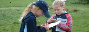 Children practising map and compass skills