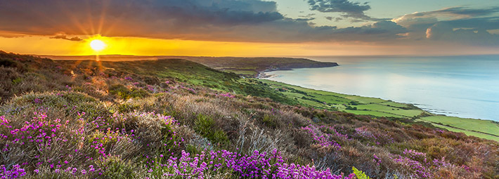 Sunset at coast Robin Hood's Bay from Ravenscar - credit Ebor Images