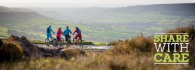Cyclists looking out towards Rosedale by Russell Burton