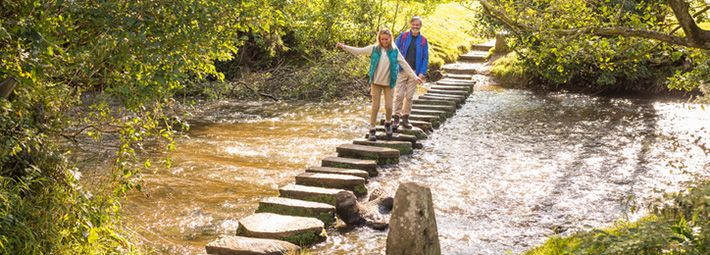 Family on stepping stones @VisitBritainImages
