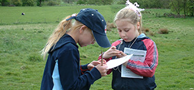 Children on map and compass skills workshop