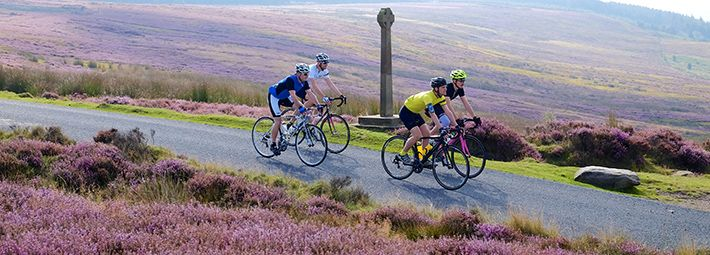 Cyclists on moorland road by Tony Bartholomew